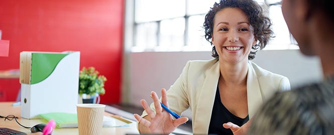 Business Woman in Meeting Header Image