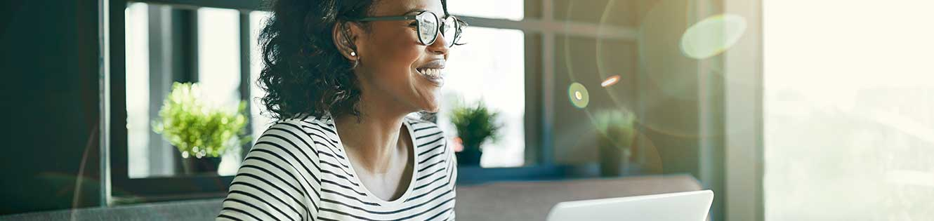 Smiling woman with glasses on porch header image