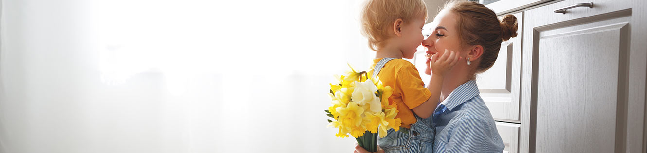 Child giving mom flowers header image