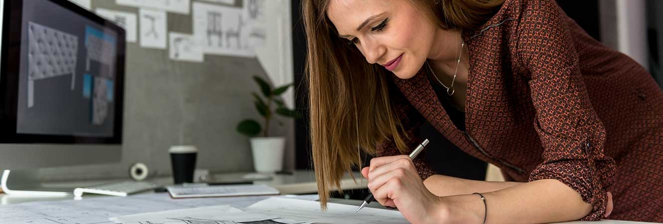 Woman taking notes while working image
