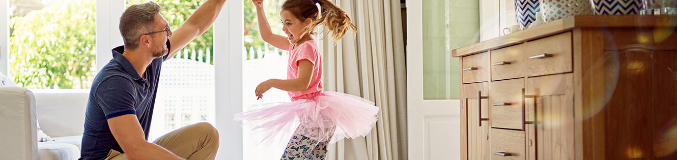 Dad dancing with young daughter in ballet tutu header image