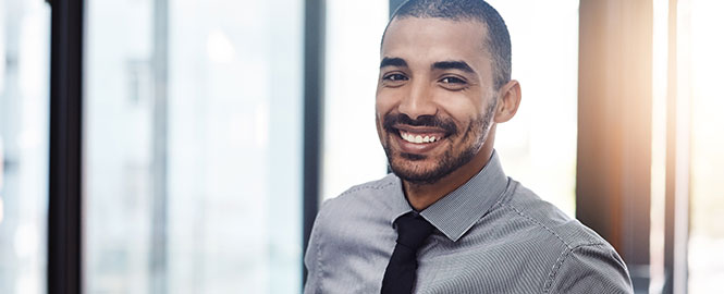 Businessman smiling header image